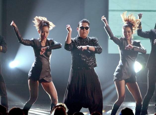 Singer PSY performs onstage during the 40th American Music Awards held at Nokia Theatre L.A. Live on November 18, 2012 in Los Angeles, California.  (Photo by Kevin Winter/Getty Images) Photo: Kevin Winter, Getty Images / 2012 Getty Images