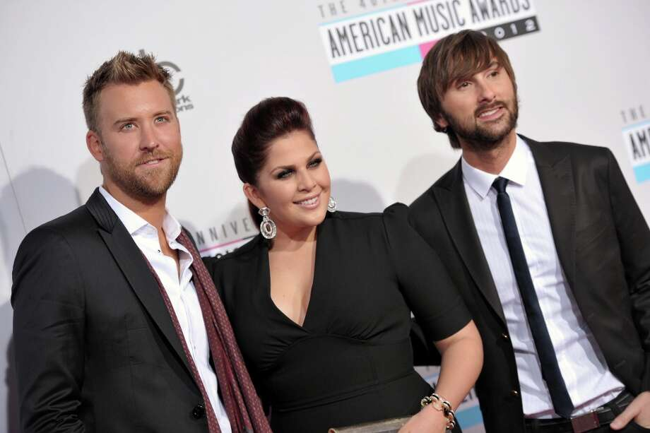 Charles Kelley, left, Hillary Scott, center, and Dave Haywood from the band Lady Antebellum arrive at the 40th Anniversary American Music Awards on Sunday, Nov. 18, 2012, in Los Angeles. (Photo by John Shearer/Invision/AP) Photo: John Shearer, Associated Press / Invision