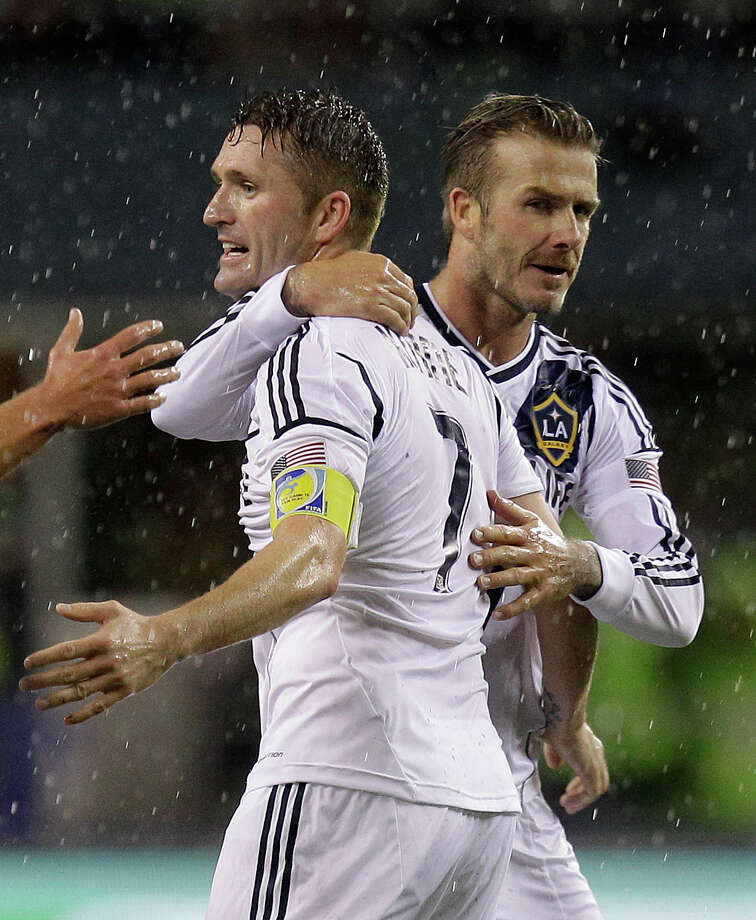 Los Angeles Galaxy's David Beckham, right, and Robbie Keane, left, celebrate winning the MLS Western Conference championship soccer match against the Seattle Sounders, Sunday, in Seattle. The Sounders and Galaxy finished Sunday's leg with a score of Sounders 2, Galaxy 1, which gave the Galaxy a 4-2 total in the two-match aggregate championship. The Galaxy will now face the Houston Dynamo in the MLS Cup on Dec. 1. (AP Photo/Ted S. Warren) Photo: Associated Press