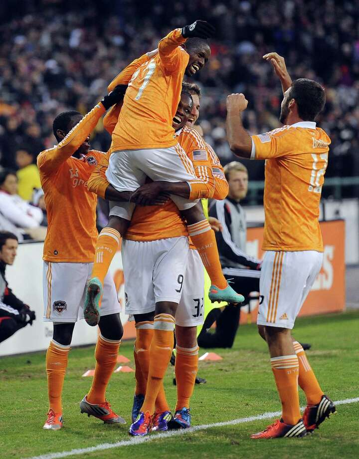 Midfielder Boniek Garcia, center, celebrates with teammates after scoring in the 34th minute to give the Dynamo the lead and put additional pressure on D.C. United to erase the aggregate deficit. Brad Davis assisted on the goal. Photo: Chuck Myers / MCT
