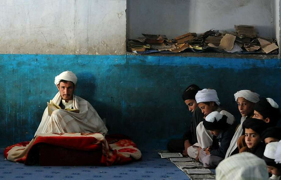 Learning their verses:Afghan children memorize the Koran at a mosque in Kandahar. Photo: Jangir, AFP/Getty Images