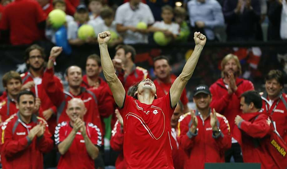 Spain's David Ferrer celebrates after defeating Czech republic's Tomas Berdych during their Davis Cup finals tennis  match in Prague, Czech Republic, Sunday, Nov. 18, 2012. Ferrer defeated Berdych and tied the match with Czech Republic 2-2. (AP Photo/Petr David Josek) Photo: Petr David Josek, Associated Press