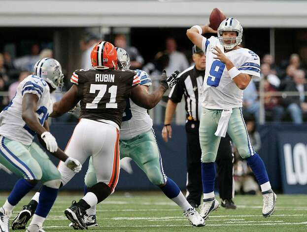 Dallas Cowboys quarterback Tony Romo (9) looks to throw the ball as Cleveland Browns defensive tackle Ahtyba Rubin (71) defends during the first half of an NFL football game Sunday, Nov. 18, 2012 in Arlington, Texas. (AP Photo/Brandon Wade) Photo: Brandon Wade, Associated Press / FR168019 AP