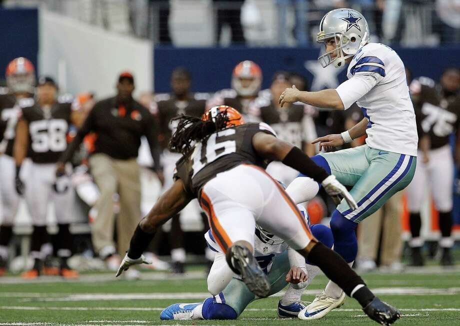 Dallas Cowboys kicker Dan Bailey (5) kicks a field goal as Cleveland Browns wide receiver Josh Cribbs (16) attempts to block the ball during the second half of an NFL football game Sunday, Nov. 18, 2012 in Arlington, Texas. (AP Photo/Brandon Wade) Photo: Brandon Wade, Associated Press / FR168019 AP