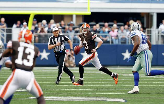 Cleveland Browns quarterback Brandon Weeden (3) looks to pass the ball to Cleveland Browns wide receiver Josh Gordon (13) as Dallas Cowboys nose tackle Jay Ratliff (90) defends second half of an NFL football game Sunday, Nov. 18, 2012 in Arlington, Texas. (AP Photo/Sharon Ellman) Photo: Sharon Ellman, Associated Press / FR170032 AP