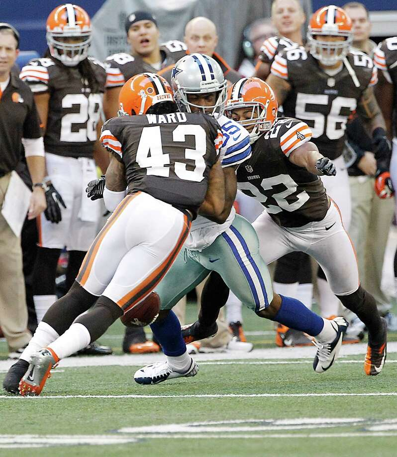 Dallas Cowboys wide receiver Kevin Ogletree (85) is tackled by Cleveland Browns strong safety T.J. Ward (43) and Cleveland Browns cornerback Buster Skrine (22) during the second half of an NFL football game Sunday, Nov. 18, 2012 in Arlington, Texas. (AP Photo/Brandon Wade) Photo: Brandon Wade, Associated Press / FR168019 AP