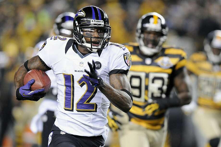 Baltimore's Jacoby Jones puts the Ravens on top by returning a punt 63 yards for a touchdown late in the first quarter. Photo: Don Wright, Associated Press