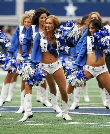 Dallas Cowboys cheerleaders perform before the start of the first half of an NFL football game against the Cleveland Browns Sunday, Nov. 18, 2012 in Arlington, Texas. (AP Photo/Brandon Wade) Photo: Brandon Wade, Associated Press / FR168019 AP