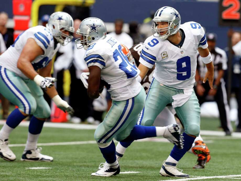Dallas Cowboys quarterback Tony Romo (9) hands the ball off to Dallas Cowboys running back Felix Jones (28) during the first half of an NFL football game against the Cleveland Browns Sunday, Nov. 18, 2012 in Arlington, Texas. (AP Photo/Sharon Ellman) Photo: Sharon Ellman, Associated Press / FR170032 AP