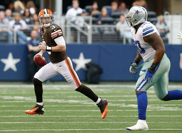 Cleveland Browns quarterback Brandon Weeden (3) looks to pass the ball as Dallas Cowboys nose tackle Jay Ratliff defends during the second half of an NFL football game Sunday, Nov. 18, 2012 in Arlington, Texas. (AP Photo/Sharon Ellman) Photo: Sharon Ellman, Associated Press / FR170032 AP