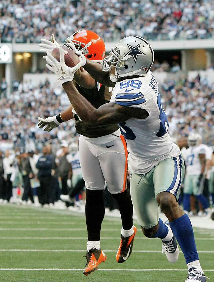 Cleveland Browns cornerback Sheldon Brown (24) is unable to block a pass for Dallas Cowboys wide receiver Dez Bryant (88) during the second half of an NFL football game Sunday, Nov. 18, 2012 in Arlington, Texas. Bryant would score a touchdown on the play. (AP Photo/Brandon Wade) Photo: Brandon Wade, Associated Press / FR168019 AP