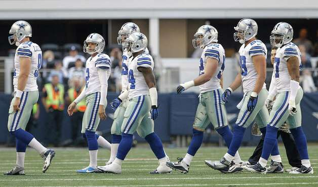 Dallas Cowboys special teams player walk to the sidelines during a timeout during the first half of an NFL football game against the Cleveland Browns Sunday, Nov. 18, 2012 in Arlington, Texas. (AP Photo/Brandon Wade) Photo: Brandon Wade, Associated Press / FR168019 AP