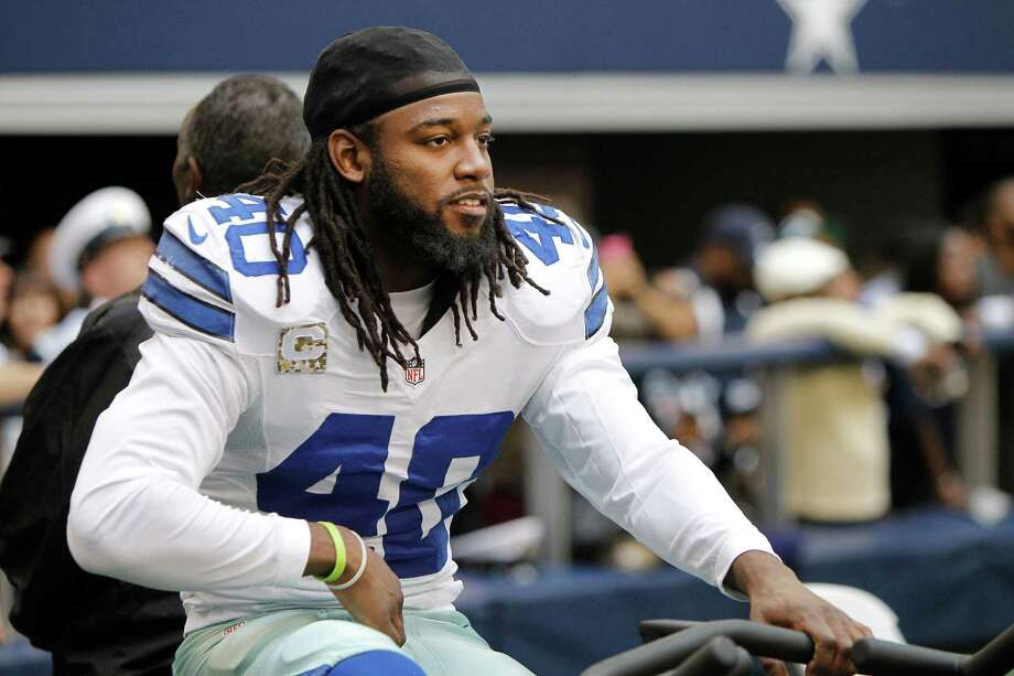 Dallas Cowboys strong safety Danny McCray (40) stays warm on an elliptical  machine during the first half of an NFL football game against the Cleveland Browns Sunday, Nov. 18, 2012 in Arlington, Texas. (AP Photo/Brandon Wade) Photo: Brandon Wade, Associated Press / FR168019 AP
