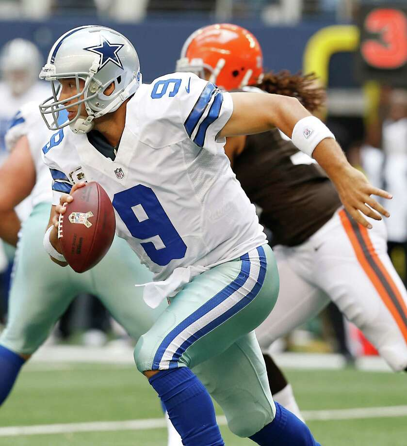 Cowboys quarterback Tony Romo (9) looks for room against the Browns' defense on Nov. 18, 2012 in Arlington. Romo can make plays with his feet as well as his arm. (AP Photo/Sharon Ellman) Photo: Sharon Ellman, Associated Press / FR170032 AP