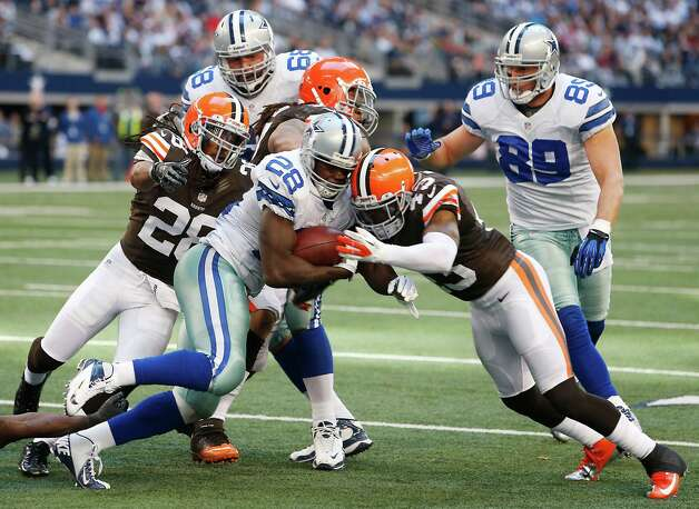 Dallas Cowboys running back Felix Jones (28) looks for room against Cleveland Browns strong safety T.J. Ward (43) during the second half of an NFL football game Sunday, Nov. 18, 2012 in Arlington, Texas. (AP Photo/Sharon Ellman) Photo: Sharon Ellman, Associated Press / FR170032 AP
