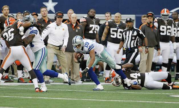Cleveland Browns cornerback Sheldon Brown (24) tries to bring down Dallas Cowboys wide receiver Miles Austin (19)  during the second half of an NFL football game Sunday, Nov. 18, 2012 in Arlington, Texas. (AP Photo/Brandon Wade) Photo: Brandon Wade, Associated Press / FR168019 AP