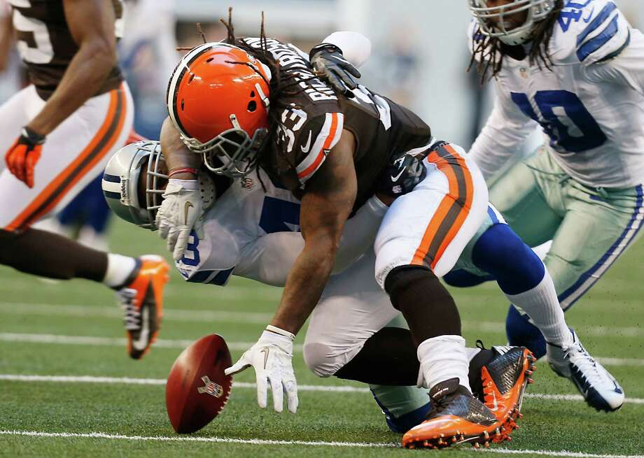 Dallas Cowboys free safety Gerald Sensabaugh (43) forces Cleveland Browns running back Trent Richardson (33) to fumble the ball during the second half of an NFL football game Sunday, Nov. 18, 2012 in Arlington, Texas. Richardson would recover the ball on the play. (AP Photo/Sharon Ellman) Photo: Sharon Ellman, Associated Press / FR170032 AP
