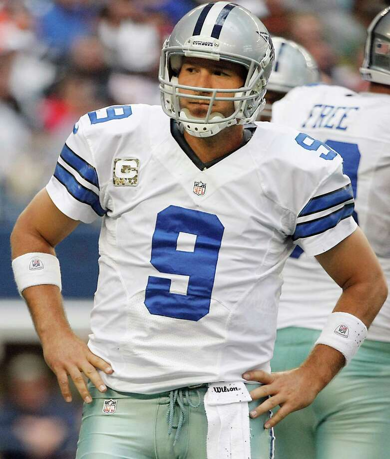 "Dallas Cowboys quarterback Tony Romo (9), wears a ""Salute to Service"" themed captains patch during the first half of an NFL football game against the Cleveland Browns Sunday, Nov. 18, 2012 in Arlington, Texas. (AP Photo/Brandon Wade) Photo: Brandon Wade, Associated Press / FR168019 AP"