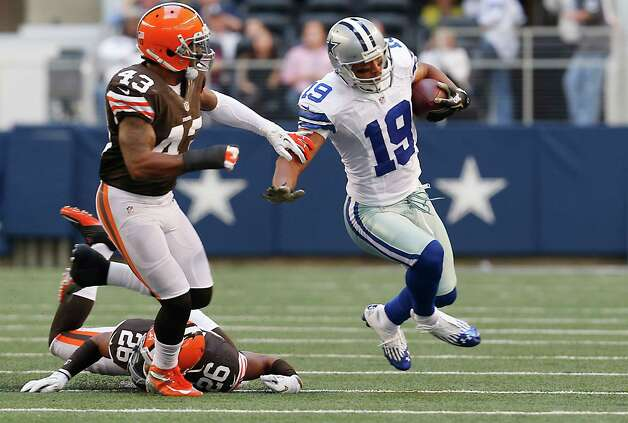 Dallas Cowboys wide receiver Miles Austin (19) looks for room against Cleveland Browns strong safety T.J. Ward (43) and Cleveland Browns cornerback Trevin Wade (26) second half of an NFL football game Sunday, Nov. 18, 2012 in Arlington, Texas. (AP Photo/Sharon Ellman) Photo: Sharon Ellman, Associated Press / FR170032 AP