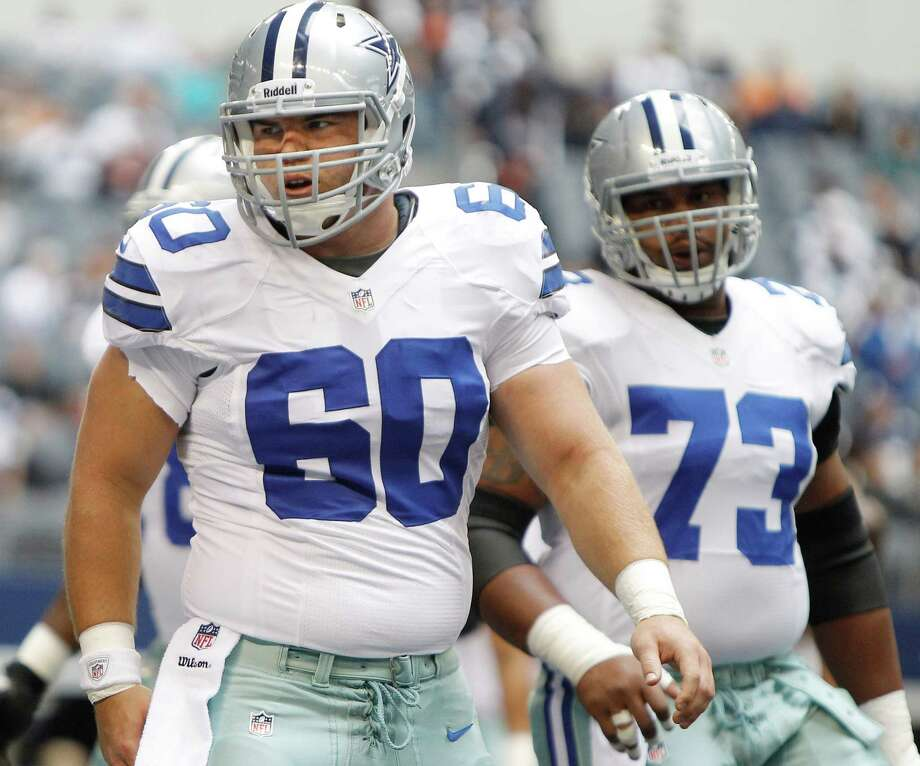 Dallas Cowboys center Kevin Kowalski (60) and Dallas Cowboys guard Mackenzy Bernadeau (73) during warmups before the start of the first half of an NFL football game against the Cleveland Browns Sunday, Nov. 18, 2012 in Arlington, Texas. (AP Photo/Brandon Wade) Photo: Brandon Wade, Associated Press / FR168019 AP