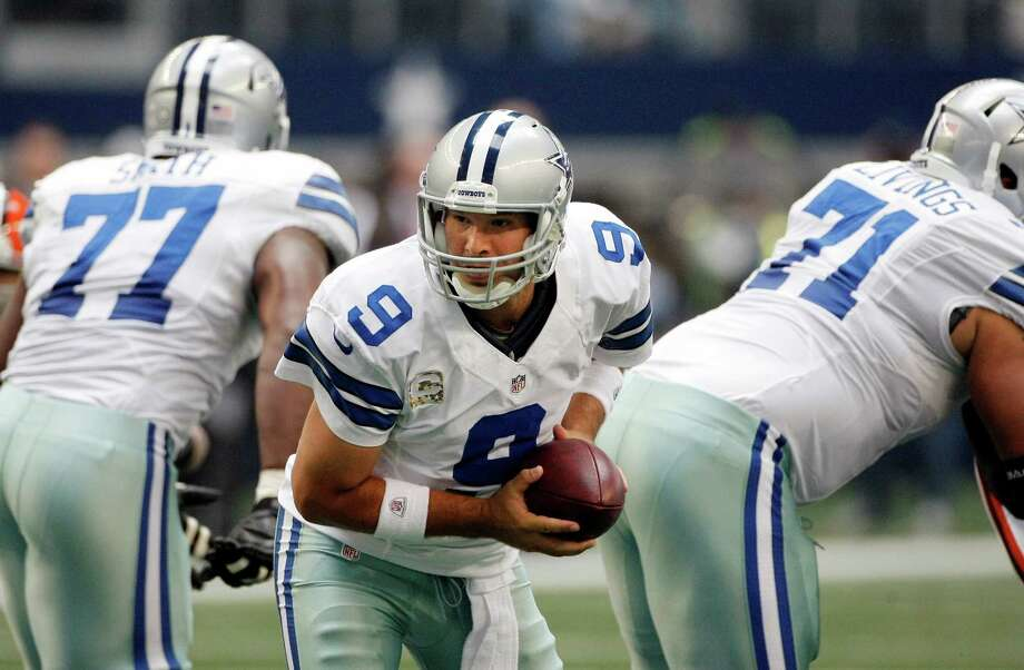 Dallas Cowboys quarterback Tony Romo (9) looks to hand off the ball during first half of an NFL football game agains the Cleveland Browns Sunday, Nov. 18, 2012 in Arlington, Texas. (AP Photo/Brandon Wade) Photo: Brandon Wade, Associated Press / FR168019 AP