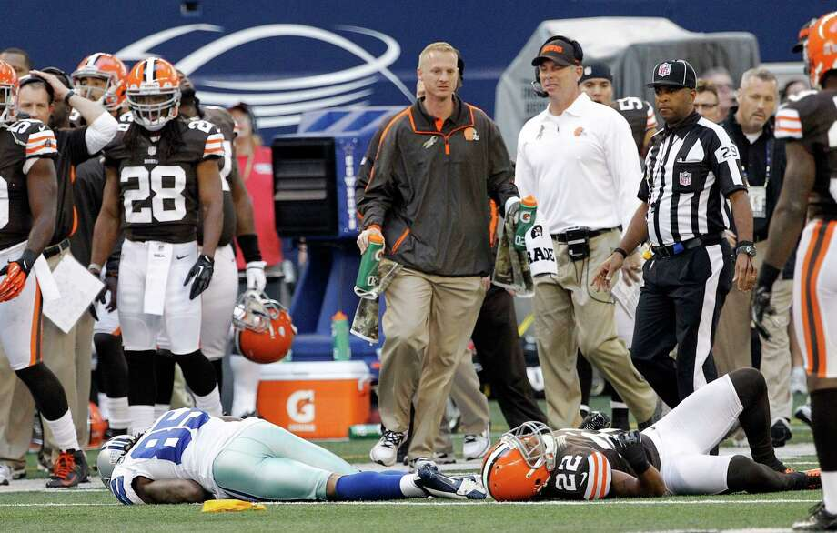 Dallas Cowboys wide receiver Kevin Ogletree (85) and Cleveland Browns cornerback Buster Skrine (22) lay motionless on the field after colliding during the second half of an NFL football game Sunday, Nov. 18, 2012 in Arlington, Texas. (AP Photo/Brandon Wade) Photo: Brandon Wade, Associated Press / FR168019 AP