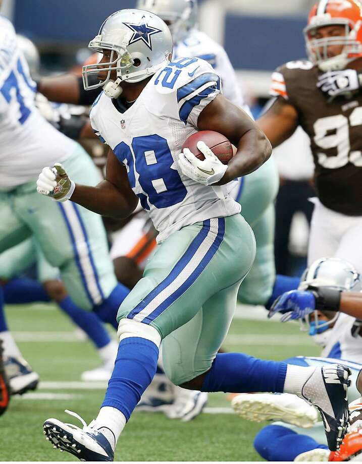 Dallas Cowboys running back Felix Jones (28) looks for room against the Cleveland Browns defense during the first half of an NFL football game Sunday, Nov. 18, 2012 in Arlington, Texas. (AP Photo/Sharon Ellman) Photo: Sharon Ellman, Associated Press / FR170032 AP