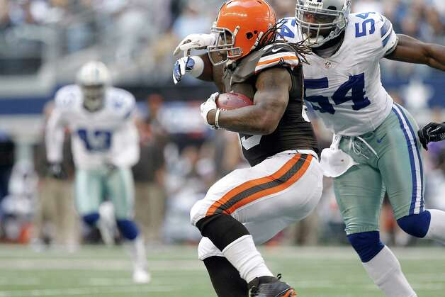 Dallas Cowboys inside linebacker Bruce Carter (54) tries to bring down Cleveland Browns running back Trent Richardson (33) during the first half of an NFL football game Sunday, Nov. 18, 2012 in Arlington, Texas. (AP Photo/Brandon Wade) Photo: Brandon Wade, Associated Press / FR168019 AP