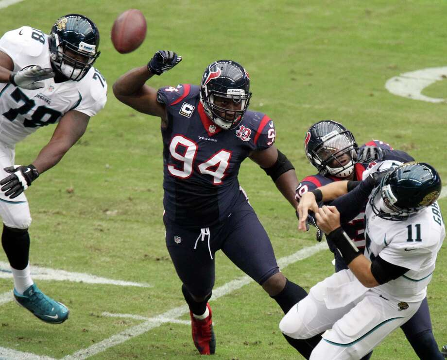 Defensive end Antonio Smith (94) played a big part in the Texans' come-from-behind win over the Jaguars, swatting away two Chad Henne passes in overtime. Photo: Nick De La Torre, Staff / © 2012  Houston Chronicle