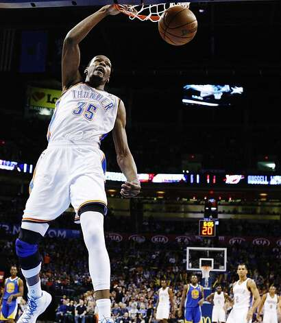 Kevin Durant dunks en route to the first triple-double of his career. Photo: Sue Ogrocki, ASSOCIATED PRESS