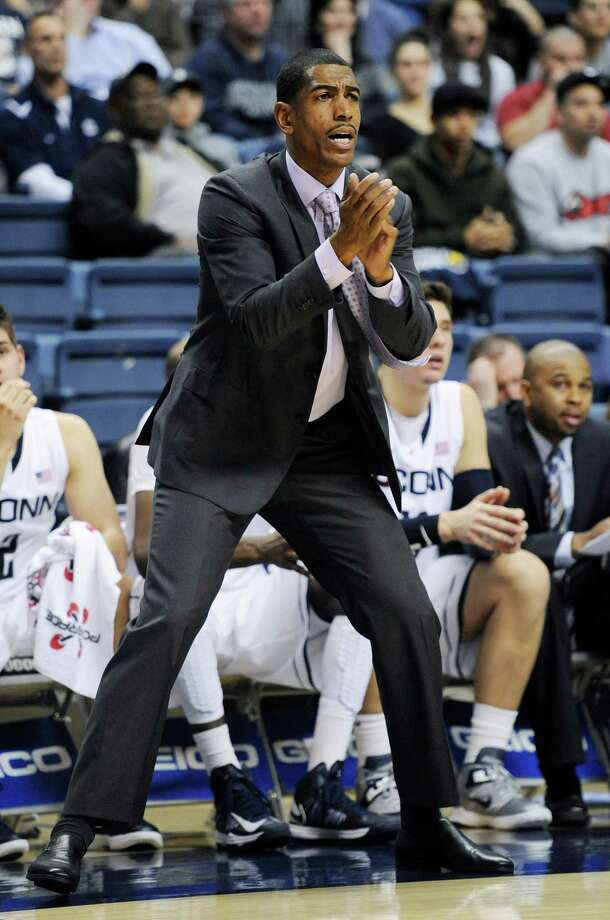 Connecticut head coach Kevin Ollie reacts in the first half of an NCAA basketball game in Storrs, Conn., Tuesday, Nov. 13, 2012. (AP Photo/Jessica Hill) Photo: Jessica Hill, Associated Press / FR125654 AP