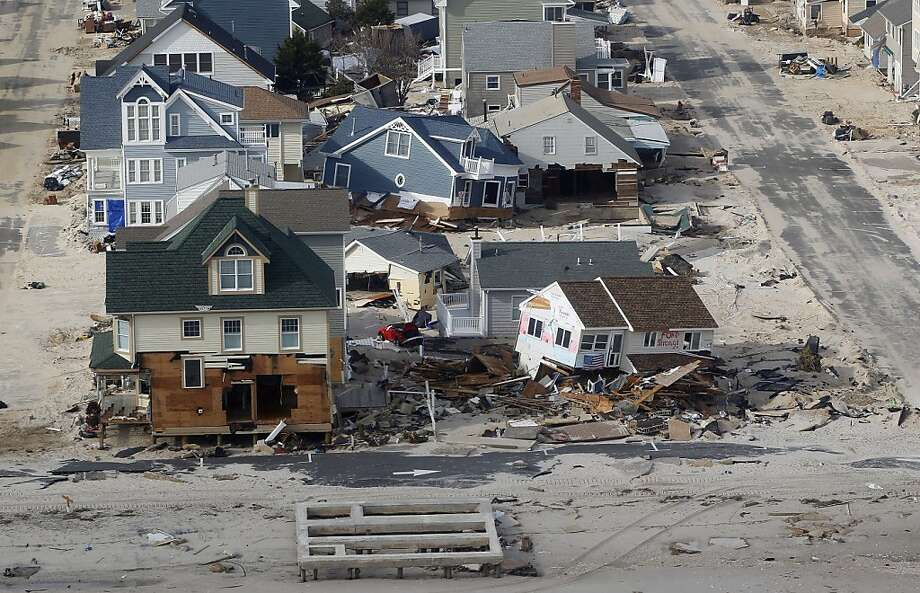Destroyed homes in Ortley Beach, N.J. as seen from the air as Vice President Joe Biden tours N.J., Sunday, Nov. 18, 2012. The Vice President was there to see the damage caused by Superstorm Sandy and to thank first responders. (AP Photo/Rich Schultz) Photo: Rich Schultz, Associated Press