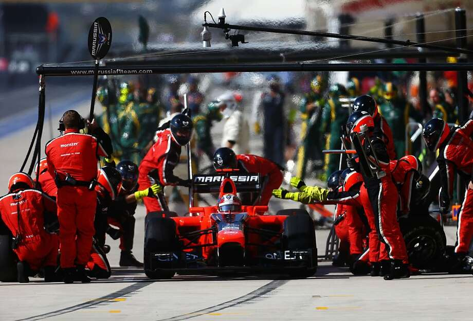AUSTIN, TX - NOVEMBER 18:  Timo Glock of Germany and Marussia stops for a pitstop during the United States Formula One Grand Prix at the Circuit of the Americas on November 18, 2012 in Austin, Texas.  (Photo by Paul Gilham/Getty Images)  Photo: Paul Gilham, Getty Images