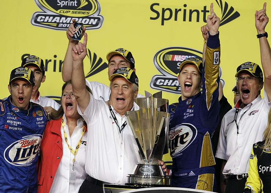 Team owner Roger Penske, third from left, and Brad Keselowski, second from right, celebrate after Keselowski won the NASCAR Sprint Cup Series championship following an auto race at Homestead-Miami Speedway in Homestead, Fla., Sunday, Nov. 18, 2012. (AP Photo/Alan Diaz) Photo: Alan Diaz, Associated Press