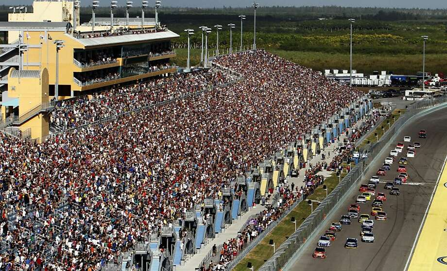 Drivers take the green flag for the start of the NASCAR Sprint Cup Series auto race at Homestead-Miami Speedway, Sunday, Nov. 18, 2012, in Homestead, Fla. (AP Photo/David Graham) Photo: David Graham, Associated Press