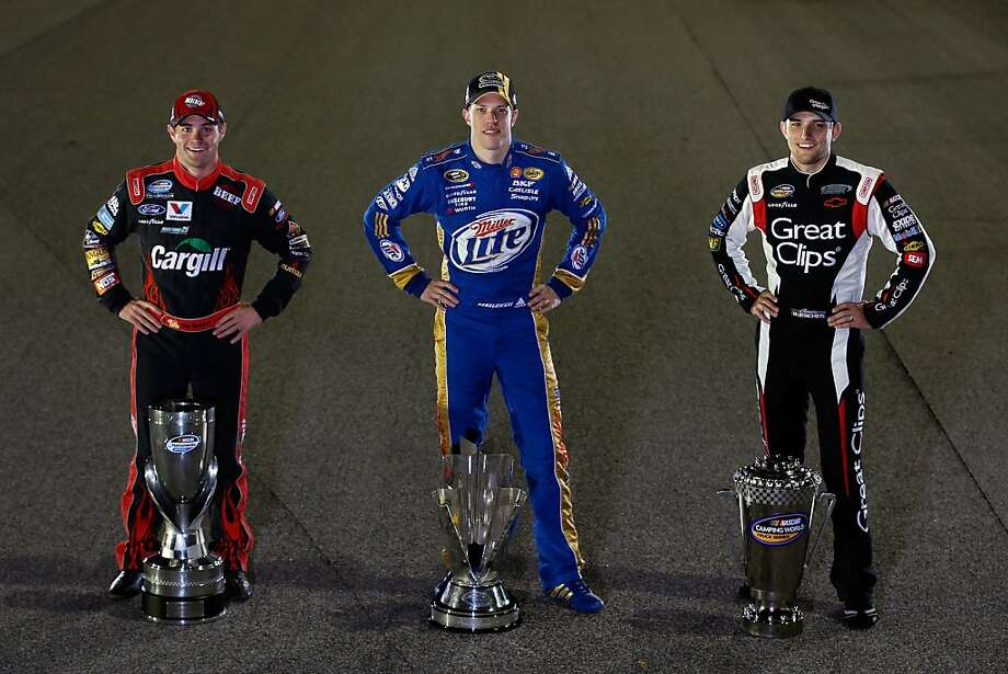 HOMESTEAD, FL - NOVEMBER 18:  Sprint Cup Champion Brad Keselowski (C), driver of the #2 Miller Lite Dodge, Nationwide Champion Ricky Stenhouse Jr. (L), driver of the #6 Cargill Ford, and Camping World Truck Series Champion James Buescher (R), driver of the #31 Great Clips Chevrolet, pose with their Series Championship Trophies after the NASCAR Sprint Cup Series Ford EcoBoost 400 at Homestead-Miami Speedway on November 18, 2012 in Homestead, Florida.  (Photo by Chris Graythen/Getty Images) Photo: Chris Graythen, Getty Images