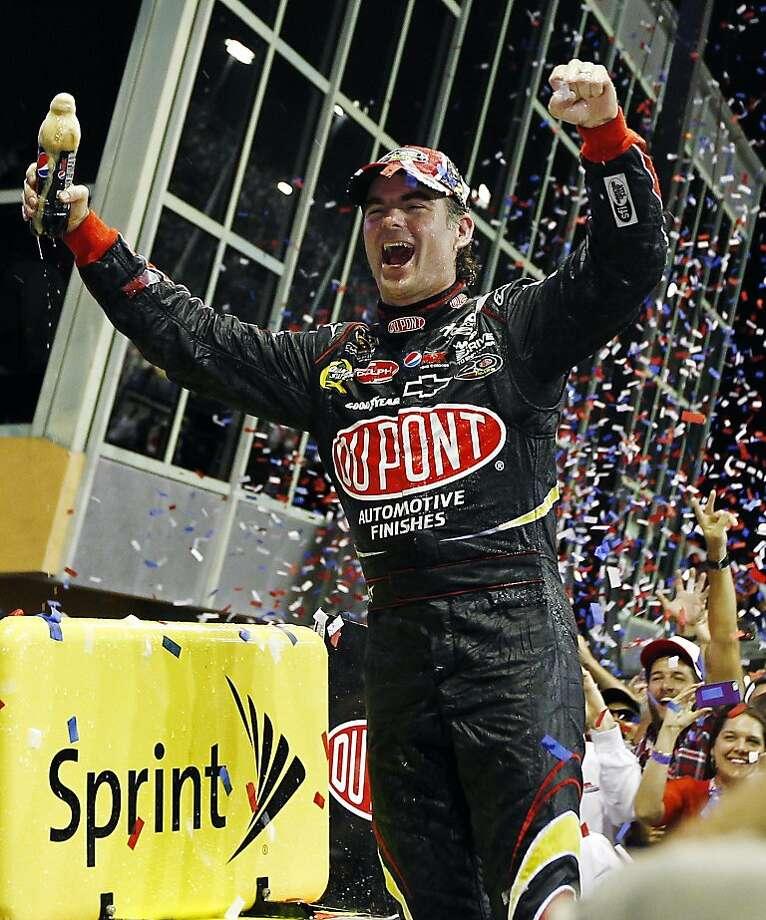 Jeff Gordon celebrates after winning the NASCAR Sprint Cup Series auto race at Homestead-Miami Speedway, Sunday, Nov. 18, 2012, in Homestead, Fla. (AP Photo/J Pat Carter) Photo: J Pat Carter, Associated Press