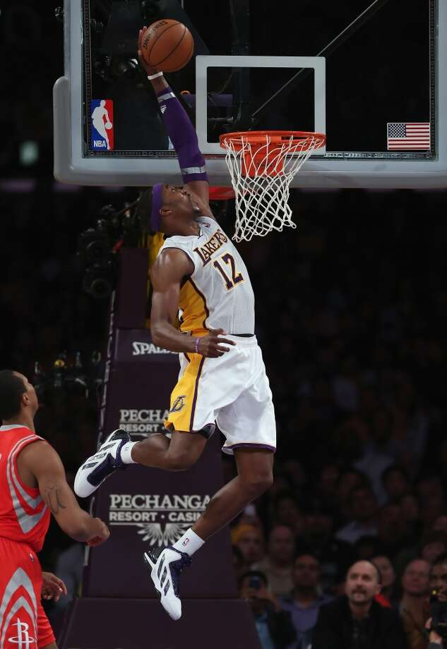 Dwight Howard of the Lakers attempts a slam. (Jeff Gross / Getty Images)