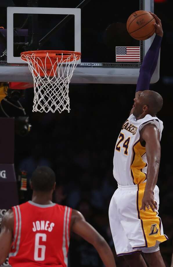 Kobe Bryant goes up for a dunk. (Jeff Gross / Getty Images)