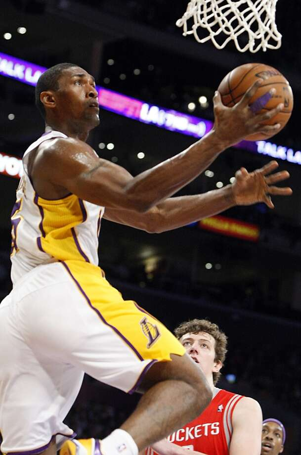Metta World Peace scores on a reverse layup against the Rockets. (Luis Sinco / McClatchy-Tribune News Service)