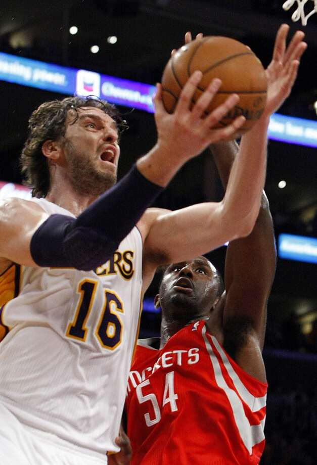 Pau Gasol drives around Rockets forward Patrick Patterson, but misses an easy layup. (Luis Sinco / McClatchy-Tribune News Service)