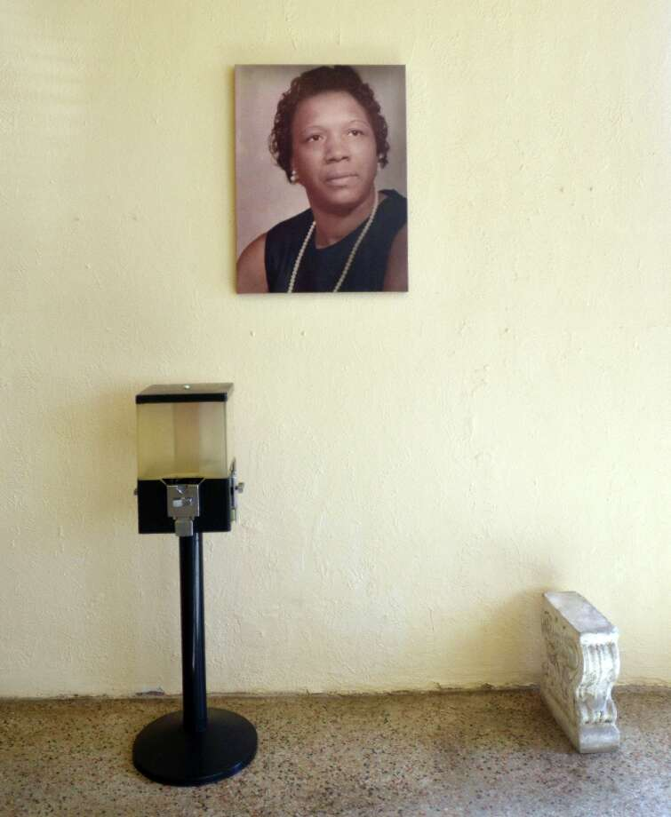 A portrait of Rosie, the matron of the family and creator of most of the recipes used at Rosie's Soul Food, hangs near the entrance. Beth Rankin/cat5 Photo: Beth Rankin / Beth Rankin