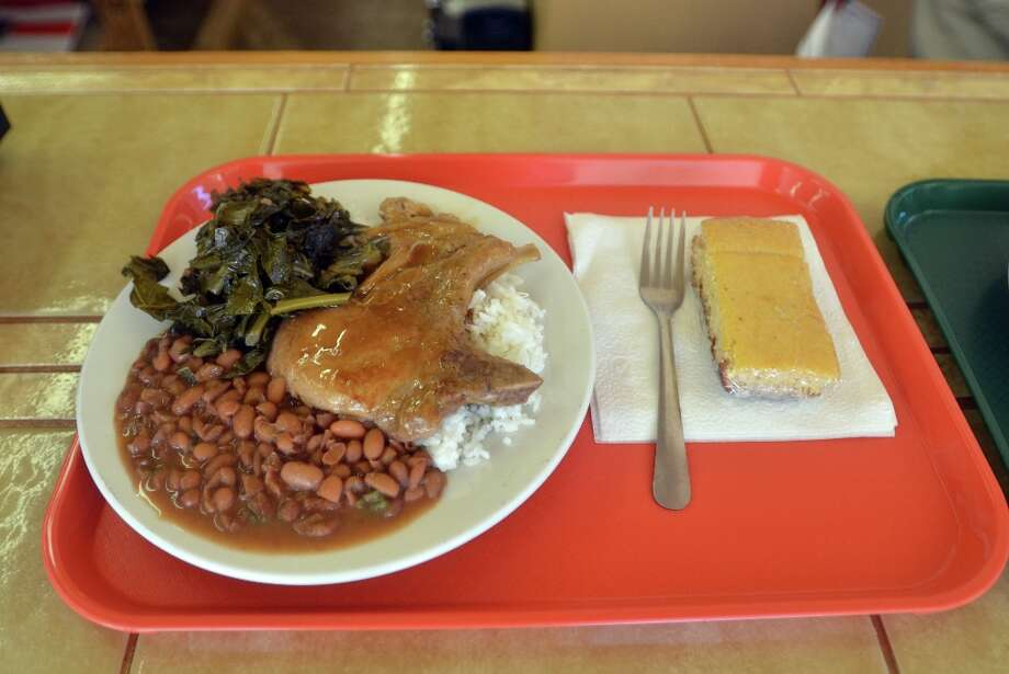 Smothered pork chops at Rosie's Soul Food. Beth Rankin/cat5 Photo: Beth Rankin / Beth Rankin