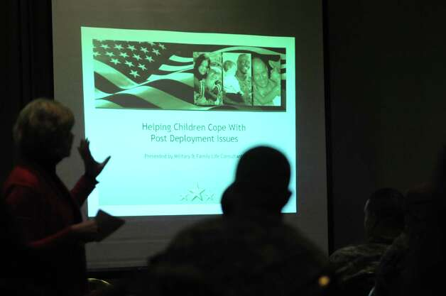 Kelly Young, left, a military family life consultant  leads a workshop on helping children during the Yellow Ribbon Reintegration Program at the Hotel Albany on Sunday, Nov. 18, 2012 in Albany, NY.  The one day event was held for New York Army National Guard members who have just recently returned from duty.  The event is designed to give the soldiers information on health and educational benefits they are entitled to along with job search and placement help.  The event is also a place for the soldiers to take part in workshops on topics such as learing to communicate with loved ones again after being away.  There is a second event held in December for the same soldiers which will also bring in Guard friendly employers to meet with soldiers looking for employment.  (Paul Buckowski / Times Union) Photo: Paul Buckowski