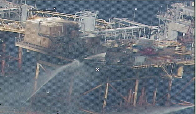 Commercial vessels spray water to extinguish a platform fire onboard West Delta 32 on November 16, 2012 in the Gulf of Mexico, approximately 20 miles offshore of Grand Isle, Lousiana. The Coast Guard was searching for two missing workers while four others were critically injured following the fire, which published reports say was sparked by workers using a torch to cut an oil line. Photo: U.S. Coast Guard, Getty Images / 2012 U.S. Coast Guard