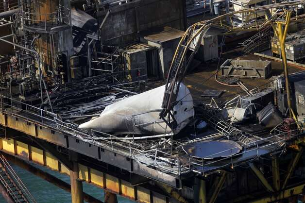 Damage from an explosion and fire on an oil platform in the Gulf of Mexico. Four people were transported to a hospital with critical burns and two were missing.