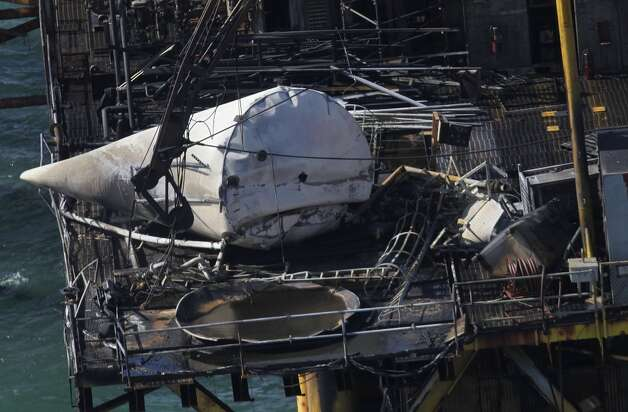 Damage from an explosion and fire on an oil platform in the Gulf of Mexico, Friday, Nov. 16, 2012. Four people were transported to a hospital with critical burns and two were missing.