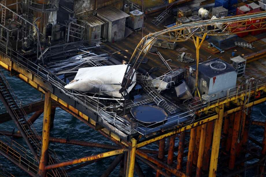 Damage from an explosion and fire on an oil platform in the Gulf of Mexico, about 25 miles southeast of Grand Isle, La. Four people were transported to a hospital with critical burns and two were missing.