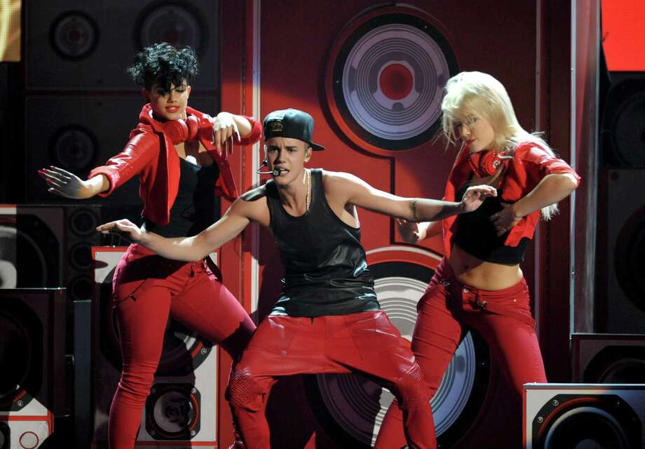 Justin Bieber performs at the 40th Anniversary American Music Awards on Sunday, Nov. 18, 2012, in Los Angeles. (Photo by John Shearer/Invision/AP) Photo: John Shearer