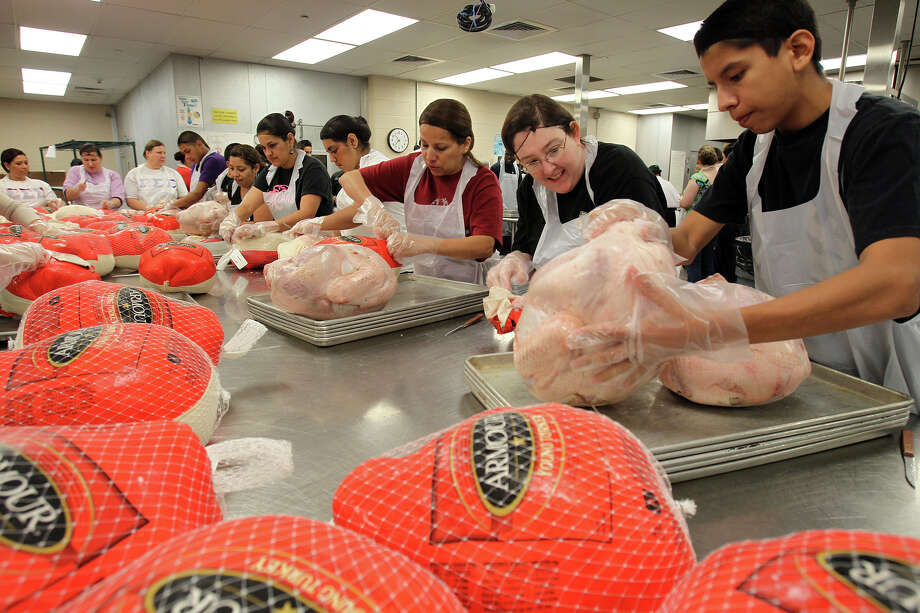 400 plus turkeys were delivered to the Convention Center for the 31st Annual Raul Jimenez Thanksgiving Dinner where volunteers began the preparation process, Nov. 21, 2010.  Photo: JENNIFER WHITNEY, Special To The Express-News / SAN ANTONIO EXPRESS-NEWS